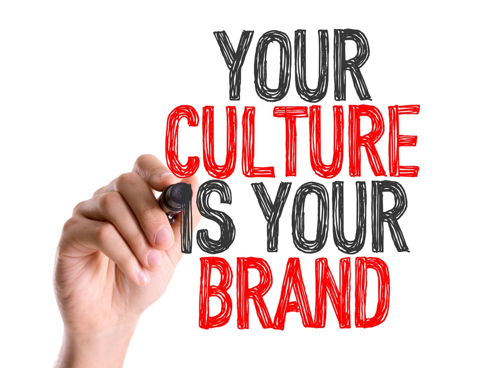 Hand with marker writing Your Culture Is Your Brand.jpeg