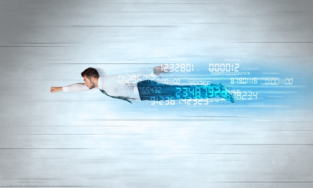 Businessman flying super fast with data numbers left behind concept.jpeg